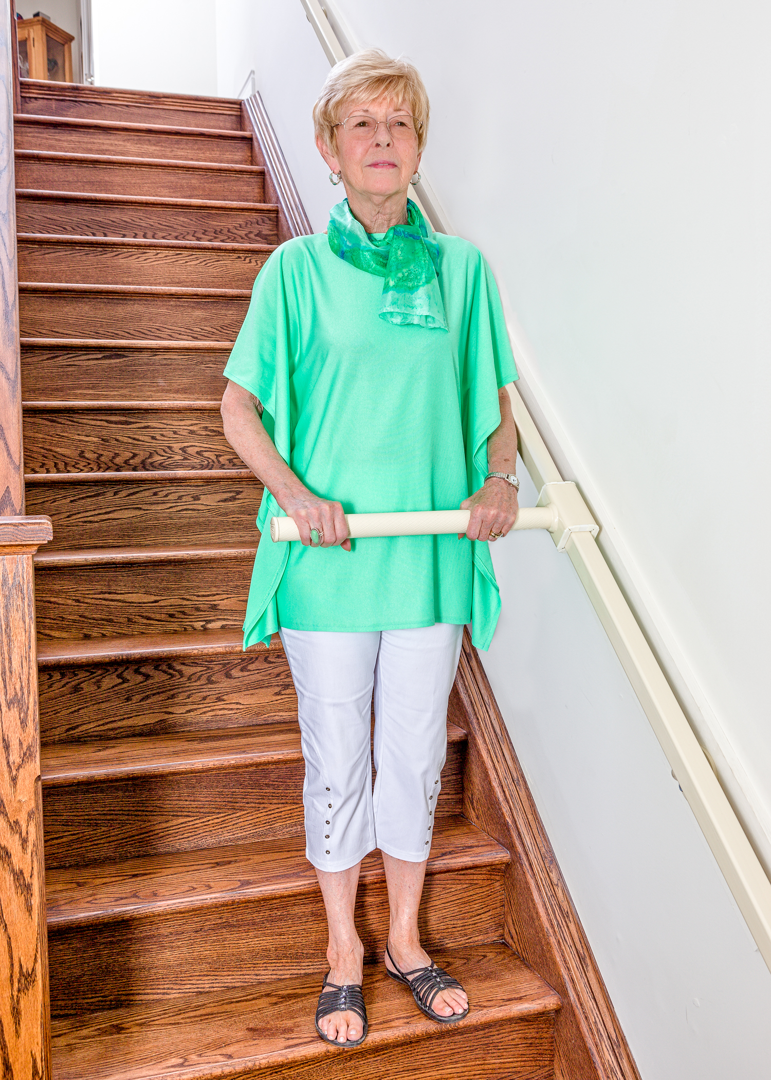 Wellwise by Shoppers Drugmart. Feel confident and safe in your home with StairSteady. Woman with StairSteady product going down the stairs.