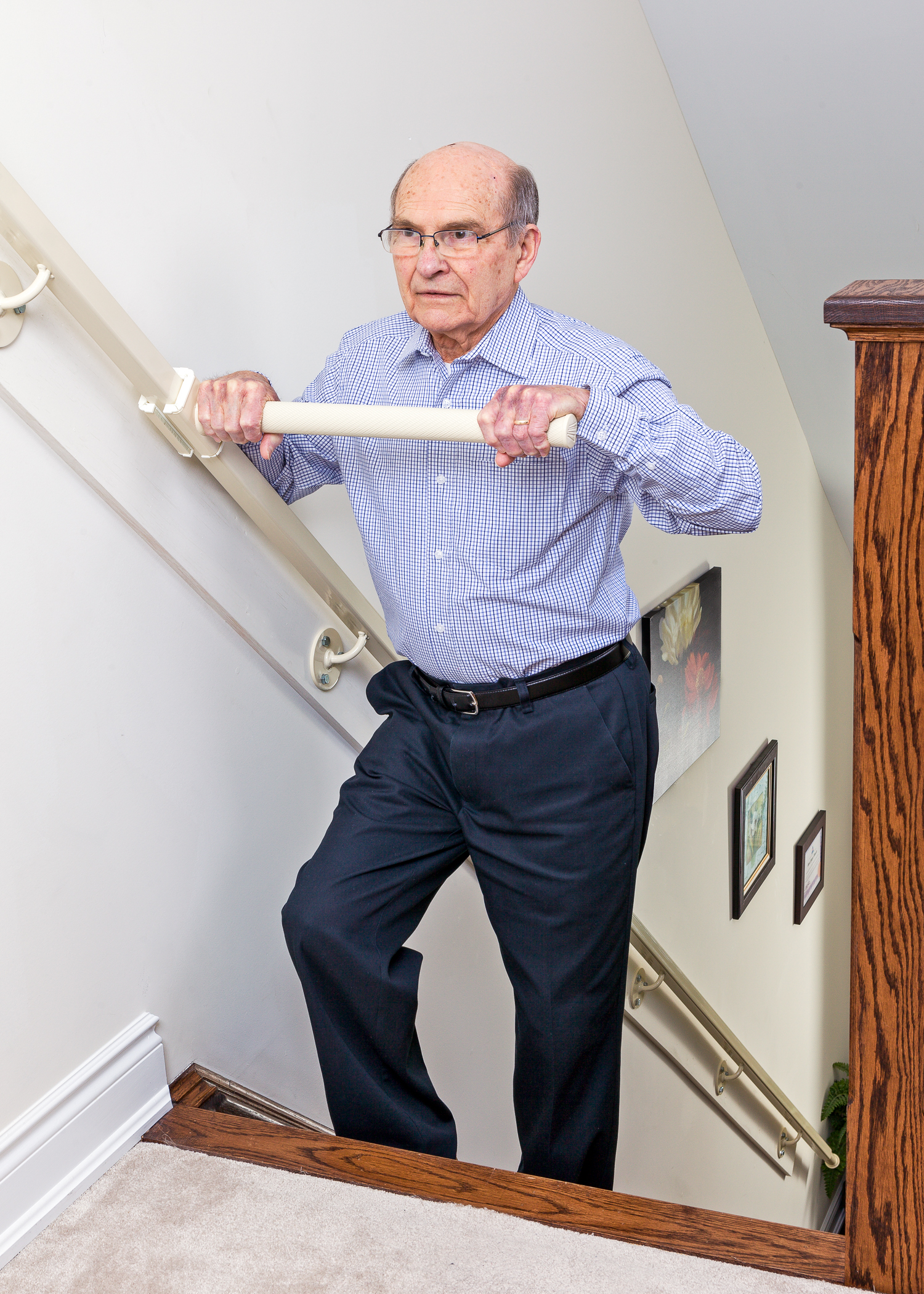 Wellwise by Shoppers Drugmart. Feel confident and safe in your home with StairSteady. Man with StairSteady product going up the stairs.